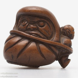 Man Carrying Daruma